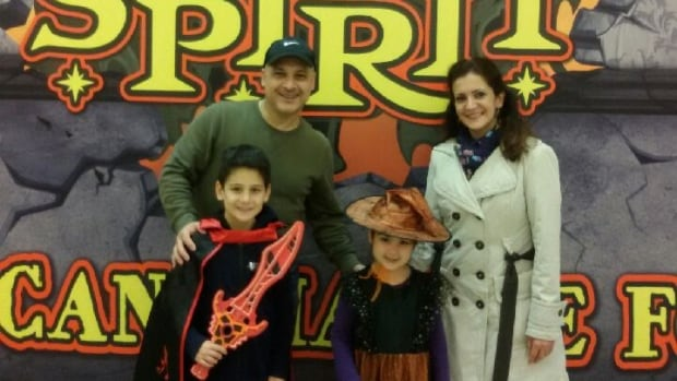 The Majarian family celebrates their first Halloween by trick-or-treating at Metrotown mall.