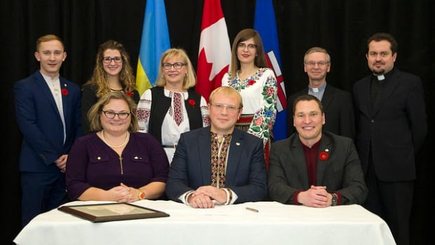 Alberta's Ukrainian-Canadian Heritage Day Act passed in the legislature on Wednesday. Seated at the table are deputy premier Sarah Hoffmann, Andriy Shevchenko, ambassador of Ukraine, and Deron Bilous, minister of economic development and trade.