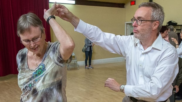 Alice-Betty Rustin and Charles Dennis participate in a Dancing with Parkinson's research project. He says it would be great to be part of the victory over the disease.