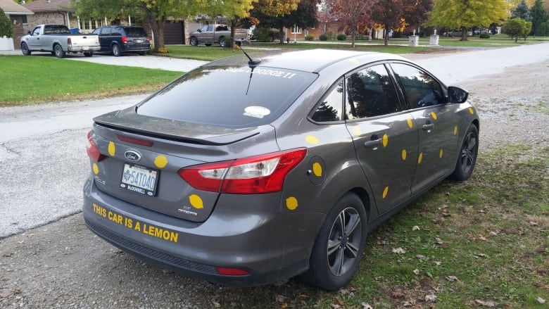 Trisha Glabb Was So Upset With Fords Response To Her Transmission Problems That She Covered Her Car With Bright Yellow Lemon Stickers And A Message That