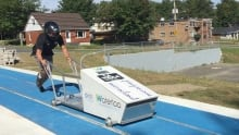 Yannik Morin, bobsleigh trainer tries out push track in Waterloo, Que.
