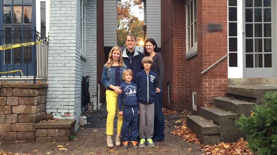 The DeCloet-Weikle family outside their Toronto two homes. From left to right:  Brandie, Derek, Amy, Alister and Cameron.