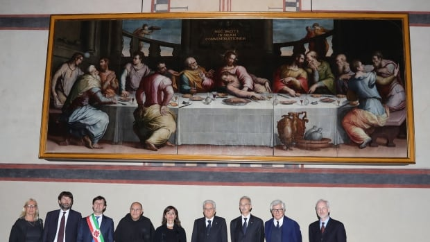 A host of dignitaries, including Italian president Sergio Mattarella (fourth from right) attend the unveiling of Giorgio Vasari's restored masterpiece The Last Supper on Nov. 4, 2016 in Florence.