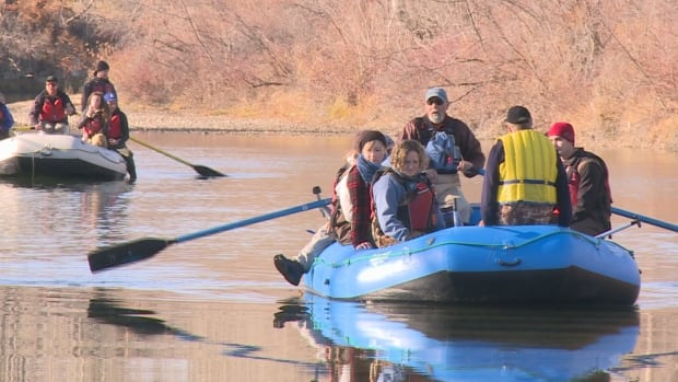 Biologists and conservationists joined with university students Friday to measure the number of redds, brown trout spawning areas, in the Elbow River.