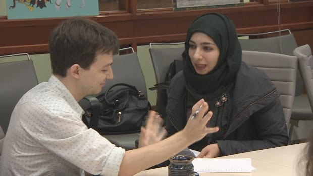 Callan Furlong and Asmaa Alzoubi teach each other their languages and share cultural knowledge at this U of T workshop.