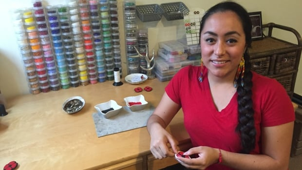 Killa Atencio has been beading custom orders of poppies, which she hopes will recognize the service of Indigenous and non-Indigenous veterans.