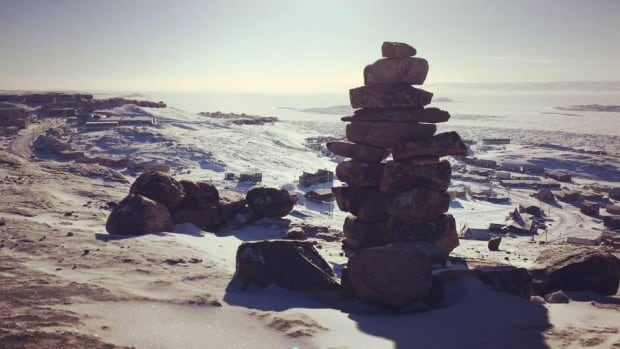 An inuksuk stands over Iqaluit. In a new report timed to coincide with proposed changes to the Education Act, professor Ian Martin predicts only 4 per cent of Inuit will speak Inuktitut at home by 2051, and says even that 'may be too generous.'