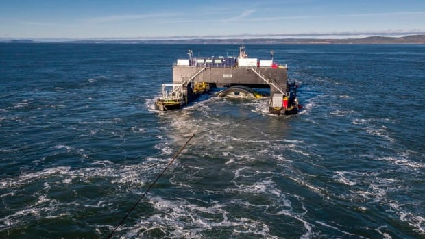 The Scotia Tide deployment barge is towed into position near Parrsboro, N.S., on Monday.