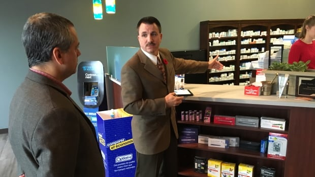 Barry Horrobin shows Peter Dumo proper depth of pharmacy counters to prevent criminals from jumping over.