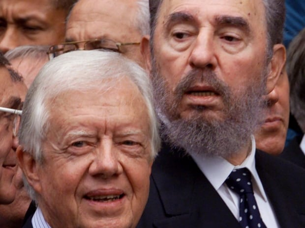 Former American president Jimmy Carter and Castro leave the church following the funeral services for Trudeau.