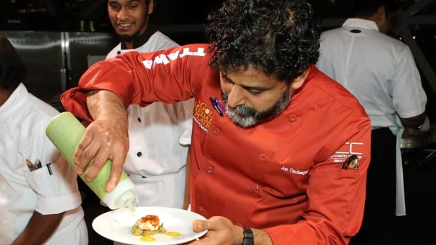 Coconut Lagoon owner and chef Joe Thottungal prepares one of the dishes in Monday evening's competition.