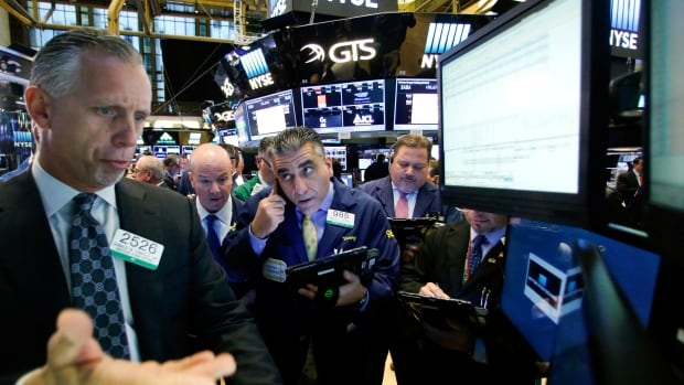 Traders work on the floor of the New York Stock Exchange in New York City on November 10, 2016.