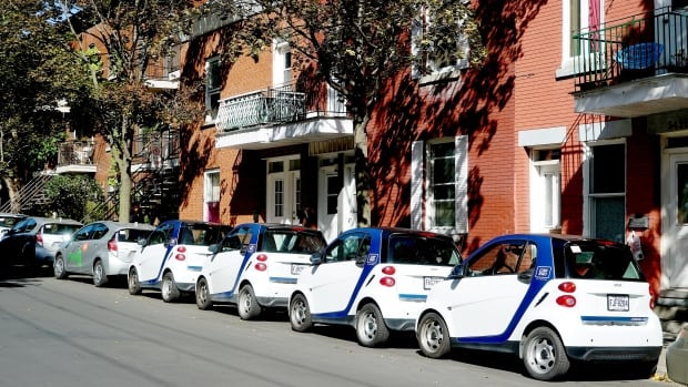 A line of self-service cars stretches up St-Dominique Street in Mile End.