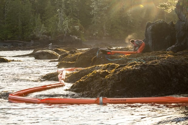 Floating booms are being used to try to protect the shoreline from spilled fuel and oil. (Tavish Campbell/Heiltsuk Nation)