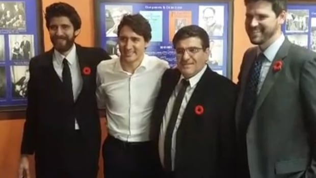 Tareq Hadhad, Prime Minister Justin Trudeau, Assam Hadhad and Liberal MP Sean Fraser pose for a photo during their meeting Thursday.