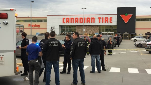 Police gather at a Canadian Tire in Vancouver, B.C., in Nov. 2016 after the fatal shooting of Daniel Peter Rintoul.