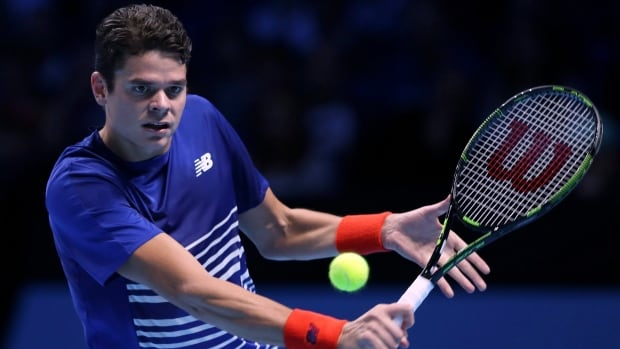 Canada's Milos Raonic plays a return to France's Gael Monfils during their ATP World Tour finals tennis match in London on Sunday.