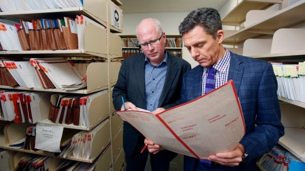 The CBC's Dave Seglins, left, and Robert Cribb of the Toronto Star underwent the RCMP's top secret security clearance so they could review case summaries at headquarters in Ottawa.