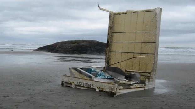 The force of the ocean reduced this shipping containers to pieces.