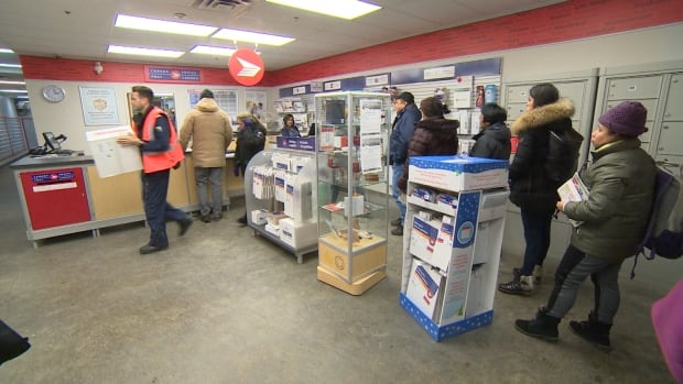 Residents line up at the mail counter in Iqaluit, one of the busiest post offices in Canada.