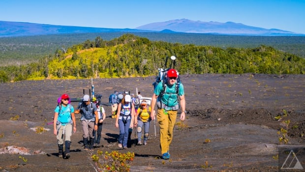 Scientists explore a volcanic region in Hawaii during an extravehicular activity excursion.