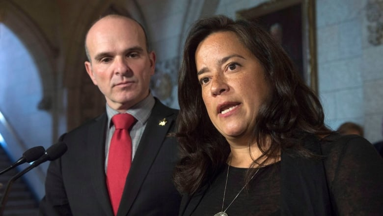 Justice Minister Jody Wilson-Raybould (right) introduced legislation  Tuesday to repeal the section of the Criminal Code that makes it illegal  for someone ...