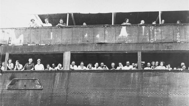 Jewish refugees aboard the MS St. Louis attempt to communicate with friends and relatives in Cuba, who were permitted to approach the docked vessel in small boats, June 3, 1939.