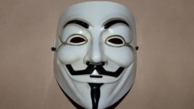 James McIntyre was wearing a Guy Fawkes mask associated with the online group Anonymous and carrying two knives when he was fatally shot by RCMP in Dawson Creek.
