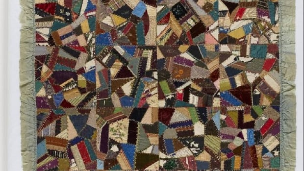 The Confederation Quilt, which will be on display at the Kings County Museum in Hampton, is made of hundreds of silk and velvet scraps and edged with a grey ruffle.