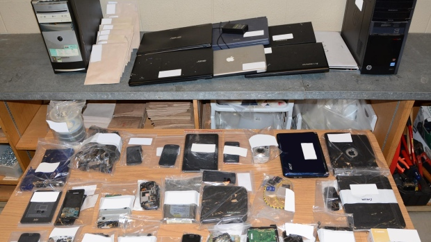 A photo of the electronics seized in Project Links, which have helped lead police to nine arrests relating to the multiple assaults of a seven-year-old girl.