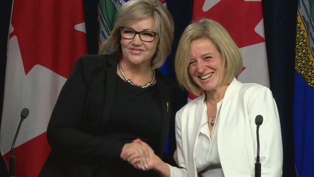 Former PC MLA Sandra Jansen (left) and Alberta Premier Rachel Notley shook hands following a news conference announcing Jansen had joined the NDP caucus.