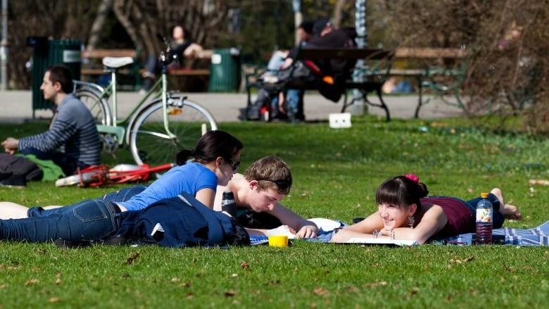 Millennials socializing in a park