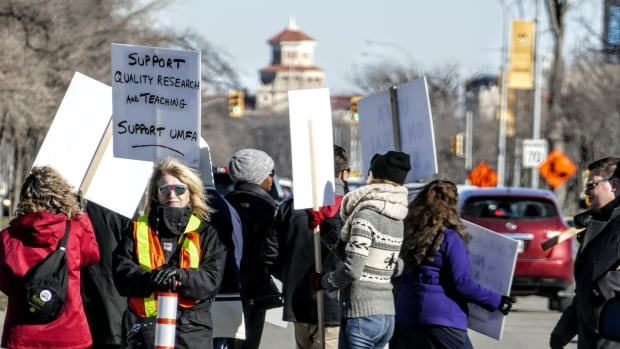 Arguments over whether a wage freeze caused the strike at the University of Manitoba dominated hearings Wednesday at the Manitoba Labour Board.
