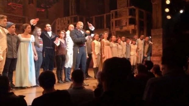 "In this image made from a video provided by Hamilton LLC, actor Brandon Victor Dixon who plays Aaron Burr, the nation's third vice president, in ""Hamilton"" speaks from the stage after the curtain call in New York, Friday, Nov. 18, 2016. Vice President-elect Mike Pence is the latest celebrity to attend the Broadway hit ""Hamilton,"" but the first to get a sharp message from a cast member from the stage."