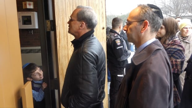 A line stretches back from the door of the Machzikei Hadas synagogue in Ottawa before a multi-faith solidarity gathering on Saturday, Nov. 19. Cameras weren't allowed inside because it happened on the Jewish Sabbath.