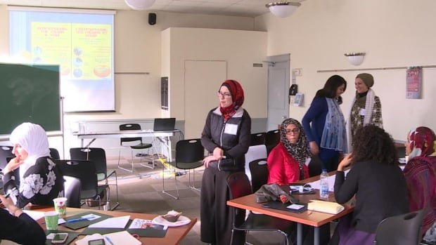 Amira Elghawaby (centre) works with the National Council of Canadian Muslims.