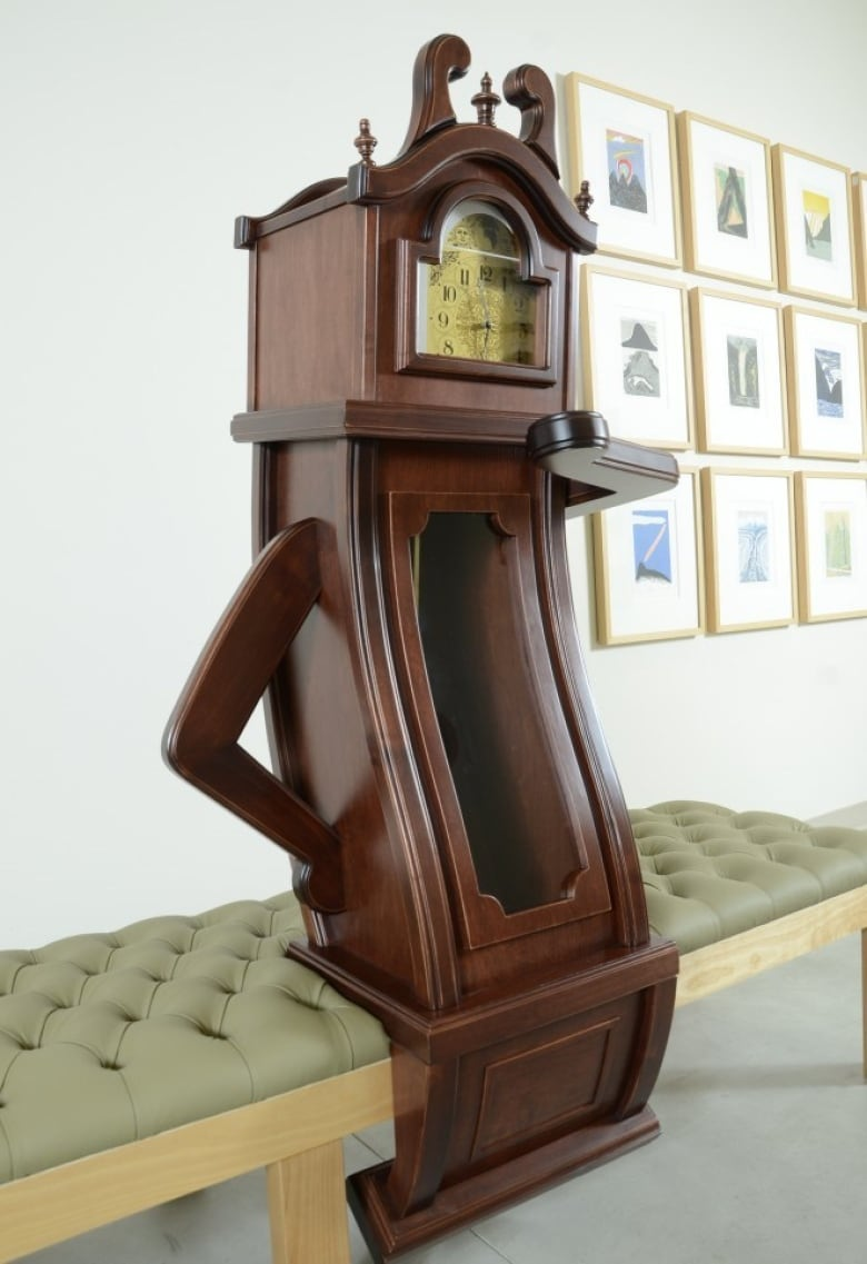 This grandfather clock takes a seat while it checks the time judson beaumont