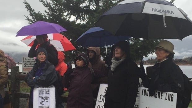 Protesters gathered in the rain in Squamish, B.C., Sunday to protest the planned Woodfibre LNG project.