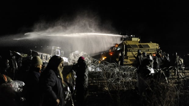 Police use a water cannon on protesters during a protest against plans to pass the Dakota Access pipeline near the Standing Rock Indian Reservation, near Cannon Ball, N.D.