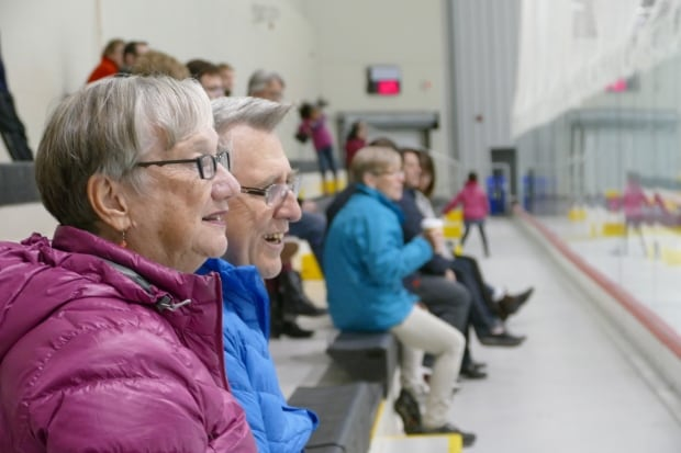 Shirley Watt (left) and husband Walter watch Omar play sledge hockey.
