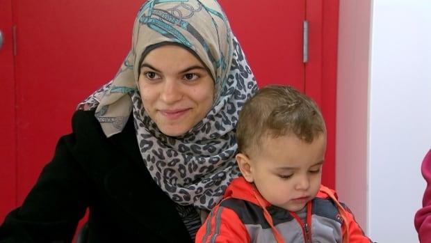 Anaam Dekka with son Ahmad. She is still getting used to life in Canada.
