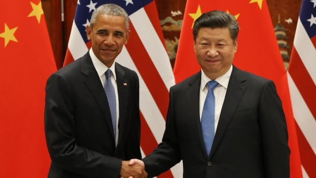 US President Barack Obama, left, and Chinese President Xi Jinping are shown in Hangzhou on Sept. 3. Prior to formally joining the Paris climate deal, the countries two years ago agreed to improve their respective efforts in reducing greenhouse gas emissions.