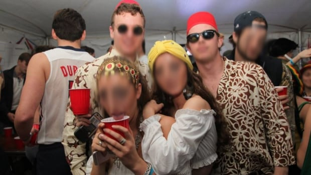 Queen's University students made national headlines this week after photos of a controversial off-campus costume party were posted online. The school says it's investigating. Faces of the students have been blurred by CBC News. (Twitter)
