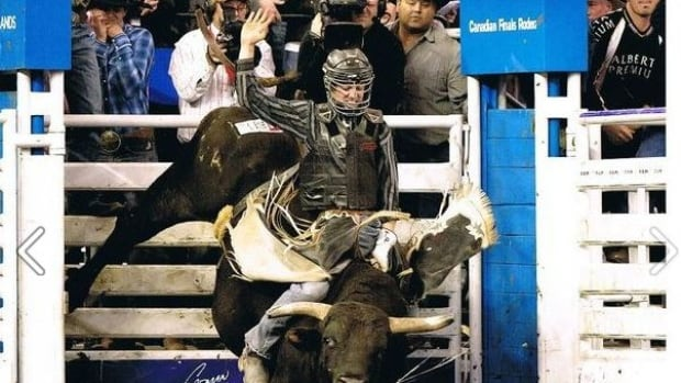 City staff in Merritt, B.C., are looking into the costs of adding 'Home of Professional Bull Rider Ty Pozzobon,' shown here, to the city's welcome sign.