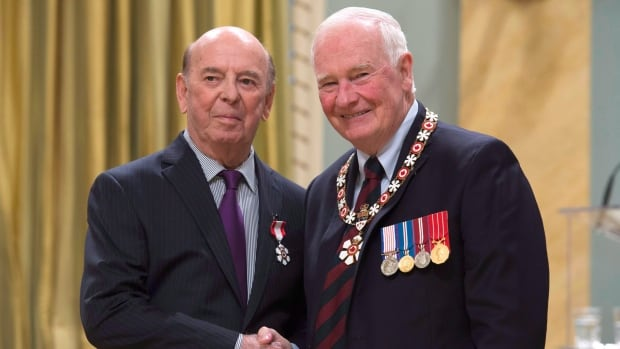 Governor General David Johnston invests Robert Cole, from St.John's, Nfld. as a Member of the Order of Canada during a ceremony at Rideau Hall Friday September 23, 2016 in Ottawa. Cole has co-written a new book about his nearly 50 years of sports broadcasting.