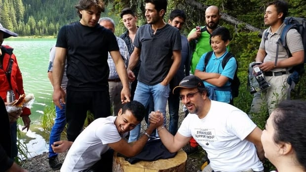 arm-wrestling 'It was very hard': Learning English a big struggle for Syrian refugees