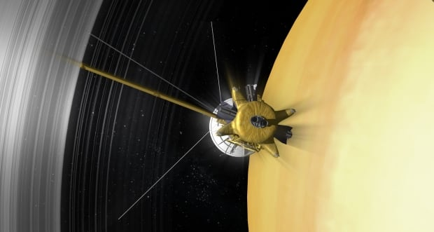 Artist's concept of Cassini orbiter diving between Saturn's inntermost rings and cloud tops.