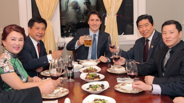 Prime Minister Justin Trudeau, centre, is flanked by Benson Wong, left, and Shenglin Xian, right, at a fundraising event at Wong's Toronto home in May. Shenglin Financial posted this image on its website under the title: Shenglin Xian and Chinese Celebrities Meets Canada Prime Minister Justin Trudeau.