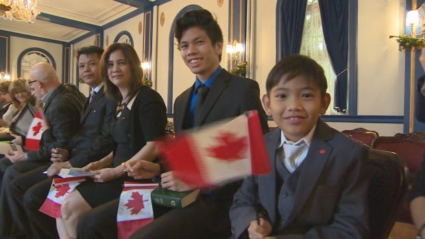 The Oyando family, originally from the Philippines, came to Canada five years ago. Here they are seated at the citizenship ceremony at Government House in Regina on Nov. 25, 2016. Canada's citizenship oath will be changing to include honouring treaties with Indigenous peoples.