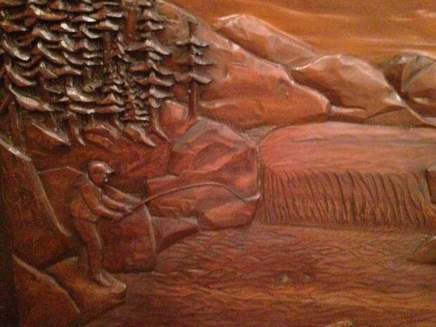 wooden mural returned